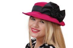 Χαμογελώντας κορίτσι με το κόκκινο καπέλο Στοκ Φωτογραφίες
