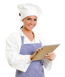 Χαμογελώντας κύριος μάγειρας με τον υπολογιστή ταμπλετών. Στοκ Φωτογραφία
