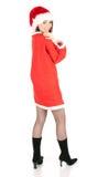 Χαμογελώντας νέα γυναίκα στα ενδύματα Santa στοκ εικόνες
