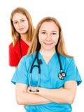 Χαμογελώντας νέοι θηλυκοί γιατροί στοκ εικόνες