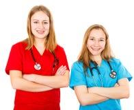 Χαμογελώντας νέοι θηλυκοί γιατροί στοκ εικόνα