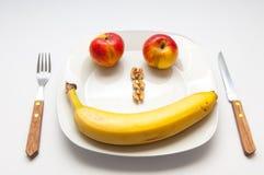 Χαμογελώντας τα φρούτα που απομονώνονται στο άσπρο υπόβαθρο Στοκ Εικόνες
