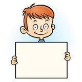 Χαμογελώντας αγόρι με την κενή οριζόντια κενή κάρτα στα χέρια Στοκ φωτογραφία με δικαίωμα ελεύθερης χρήσης