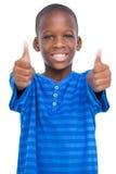 Χαμογελώντας αγόρι με τους αντίχειρες επάνω Στοκ φωτογραφία με δικαίωμα ελεύθερης χρήσης