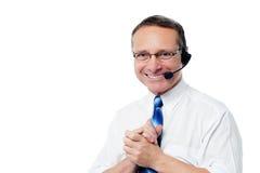 Χαμογελώντας ανώτερος υπάλληλος υποστήριξης πελατών Στοκ Φωτογραφία