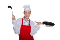 Χαμογελώντας αρχιμάγειρας με την κουτάλα και το τηγάνι Στοκ Εικόνες