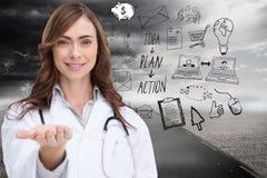 Χαμογελώντας γιατρός που παρουσιάζει το χέρι της Στοκ Φωτογραφίες
