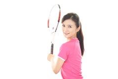 Χαμογελώντας γυναίκα με μια ρακέτα αντισφαίρισης Στοκ εικόνες με δικαίωμα ελεύθερης χρήσης