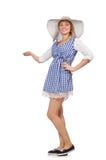 Χαμογελώντας γυναίκα στο απλό φόρεμα καρό και καπέλο που απομονώνεται στο μόριο Στοκ Φωτογραφία