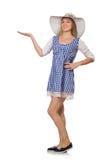 Χαμογελώντας γυναίκα στο απλό φόρεμα καρό και καπέλο που απομονώνεται στο μόριο Στοκ Εικόνες