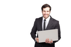 Χαμογελώντας επιχειρηματίας με ένα lap-top Στοκ Εικόνα