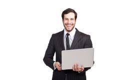 Χαμογελώντας επιχειρηματίας με ένα lap-top Στοκ Εικόνες