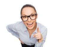 Χαμογελώντας επιχειρηματίας με το δάχτυλο επάνω Στοκ Εικόνες