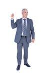 Χαμογελώντας επιχειρηματίας που δείχνει κάτι με το χέρι του Στοκ εικόνες με δικαίωμα ελεύθερης χρήσης