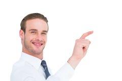 Χαμογελώντας επιχειρηματίας που δείχνει με το δάχτυλό του Στοκ Φωτογραφίες