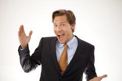 Χαμογελώντας επιχειρηματίας που παρουσιάζει μια έννοια Στοκ Εικόνες