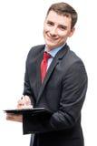 Χαμογελώντας ευτυχής επιχειρηματίας στο κοστούμι με τα σημαντικά έγγραφα Στοκ εικόνες με δικαίωμα ελεύθερης χρήσης