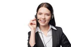 Χαμογελώντας ελκυστική γυναίκα με το ακουστικό Στοκ Φωτογραφία