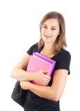 Χαμογελώντας ελκυστική γυναίκα σπουδαστής με backpack τα βιβλία εκμετάλλευσης Στοκ Εικόνες