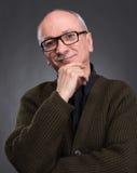 Χαμογελώντας ηλικιωμένο άτομο στα γυαλιά Στοκ Φωτογραφία