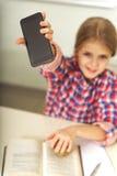 Χαμογελώντας θηλυκός μαθητής στην τάξη Στοκ Φωτογραφίες