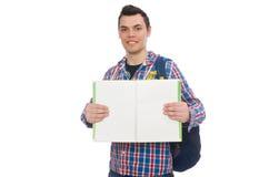 Χαμογελώντας καυκάσιος σπουδαστής με το σακίδιο πλάτης και βιβλίο που απομονώνεται στο whi Στοκ φωτογραφία με δικαίωμα ελεύθερης χρήσης