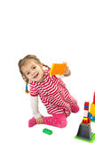 Χαμογελώντας κορίτσι με τα παιχνίδια στοκ εικόνες με δικαίωμα ελεύθερης χρήσης