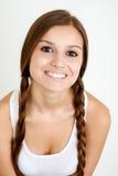 Χαμογελώντας κορίτσι με τις πλεξούδες Στοκ εικόνες με δικαίωμα ελεύθερης χρήσης