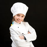 Χαμογελώντας κορίτσι στο άσπρο κοστούμι αρχιμαγείρων Στοκ φωτογραφίες με δικαίωμα ελεύθερης χρήσης