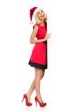 Χαμογελώντας κορίτσι Santa και μεγάλο λευκό διάστημα αντιγράφων Στοκ Εικόνα
