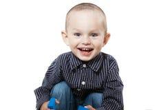 Χαμογελώντας μικρό παιδί στο λευκό Στοκ φωτογραφία με δικαίωμα ελεύθερης χρήσης