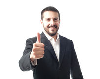 Χαμογελώντας νέος καυκάσιος επιχειρηματίας με τους αντίχειρες επάνω Στοκ Φωτογραφίες