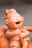 Χαμογελώντας παιδί φιαγμένο από άργιλο Στοκ Εικόνες