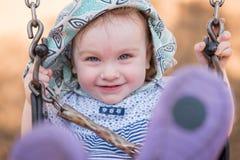 Χαμογελώντας ταλαντεμένος κορίτσι Στοκ Φωτογραφίες
