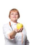 Χαμόγελο γυναικών ιατρών με τη λαβή στηθοσκοπίων Στοκ Εικόνα