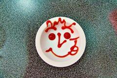 Χαμόγελο σάλτσας στο πιάτο Στοκ Φωτογραφίες