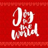 χαρά στον κόσμο Ευχετήρια κάρτα Χριστουγέννων με την καλλιγραφία βουρτσών Γραφή στο κόκκινο πλεκτό υπόβαθρο διανυσματική απεικόνιση