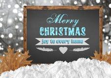 Χαρά Χαρούμενα Χριστούγεννας σε κάθε σπίτι στον πίνακα με το δάσος leav Στοκ Φωτογραφίες