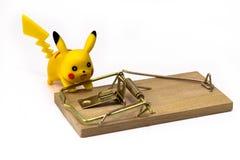 Χαρακτήρας παιχνιδιών Pickachu Pokemon από Pokemon anime, και ποντικοπαγήδα Στοκ Εικόνα