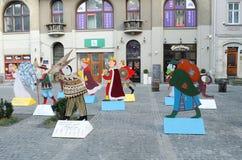 Χαρακτήρες των κάλαντων Χριστουγέννων, σε ένα από τα τετράγωνα Στοκ Εικόνες