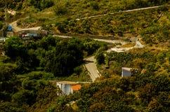 Χαρακτηριστικά ισπανικά του χωριού σπίτια και καλλιεργήσιμο έδαφος στους λόφους του anda Στοκ εικόνα με δικαίωμα ελεύθερης χρήσης