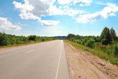 Χαρακτηριστικός αγροτικός δρόμος ασφάλτου Στοκ Εικόνα