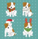 Χαριτωμένα άσπρα σκυλιά Χριστουγέννων με τα καφετιά σημεία Στοκ Εικόνες