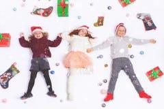 Χαριτωμένα παιδάκια Παρασκευής Χαρούμενα Χριστούγεννας 2016 μαύρα Στοκ Εικόνα