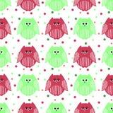Χαριτωμένες πράσινες και κουκουβάγιες καρμινίου με τα σημεία στο υπόβαθρο Στοκ Εικόνες