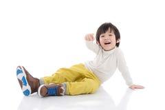 Χαριτωμένη ασιατική υπόδειξη παιδιών Στοκ Εικόνες