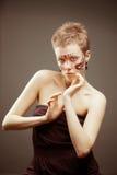 Χαριτωμένη χρωματισμένη γυναίκα Στοκ Φωτογραφία
