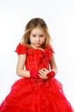 Χαριτωμένος λίγη πριγκήπισσα που ντύνεται στον κόκκινο χορό απομονωμένος στο άσπρο β Στοκ Φωτογραφίες