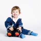 Χαριτωμένος λίγο μωρό ναυτικών στο λευκό Στοκ εικόνα με δικαίωμα ελεύθερης χρήσης