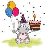 Χαριτωμένος χρόνια πολλά με το hippo διασκέδασης που κρατά τρία μπαλόνια και ένα κέικ απεικόνιση αποθεμάτων